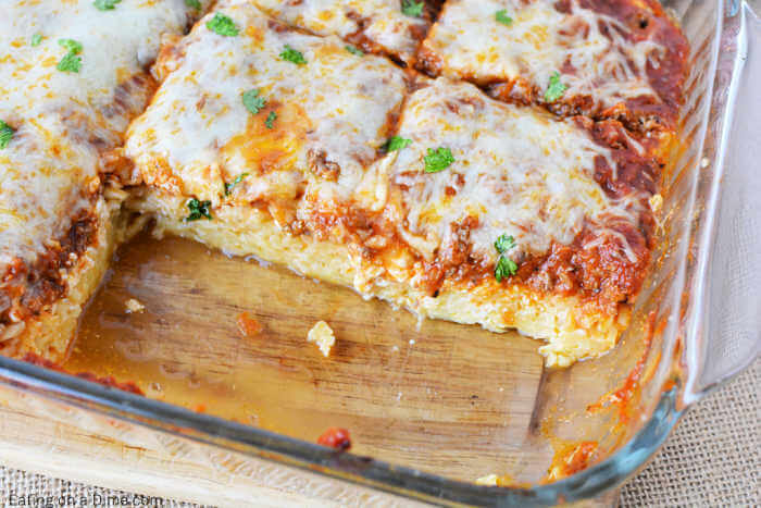 Spaghetti pie in baking dish that is cut and ready to serve.
