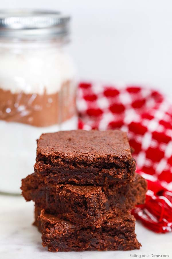 Learn how to make your own homemade brownie mix to save yourself time and money when making desserts. You will love that you can make brownies quicker with this DIY brownie mix in a jar. Try this recipe today! #eatingonadime #homemadebrowniemix #browniemixrecipe