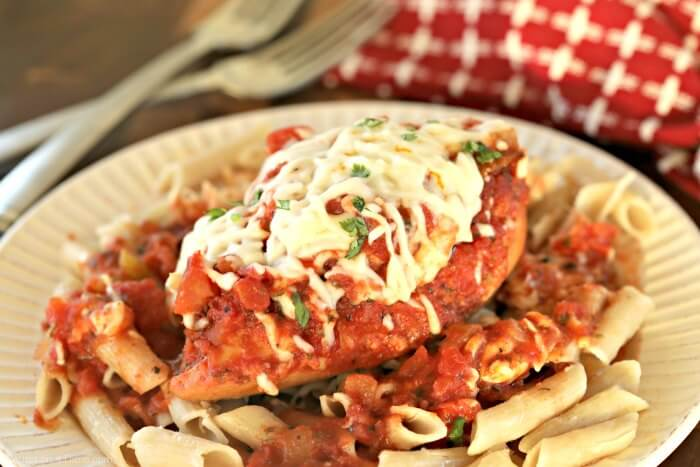 photo of pizza chicken over pasta