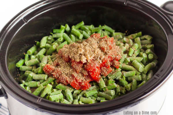 One pot meals are such a time saver around here and thisCrock Pot Pork Chop Dinner does not disappoint. Enjoy tender pork, green beans and tomatoes!
