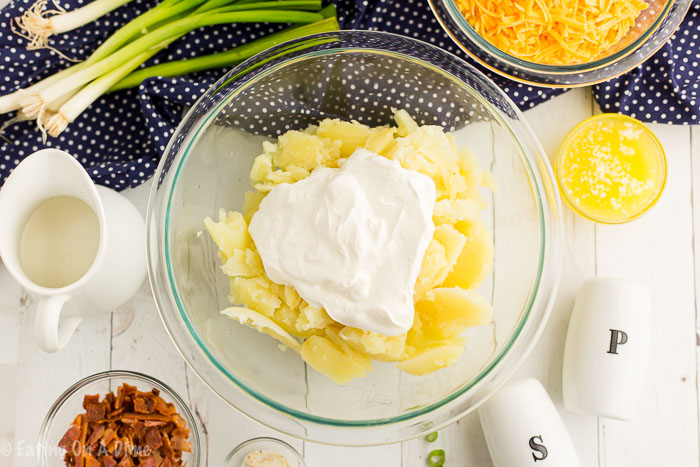 Twice Baked Potatoes are so simple and make the perfect side dish. If you can make mashed potatoes, you can easily make these quick twice baked potatoes.