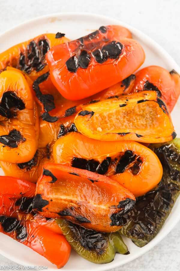 Learn how to grill bell peppers for the perfect side dish for chicken, fish and more. The grill makes this tasty with perfectly crispy edges.