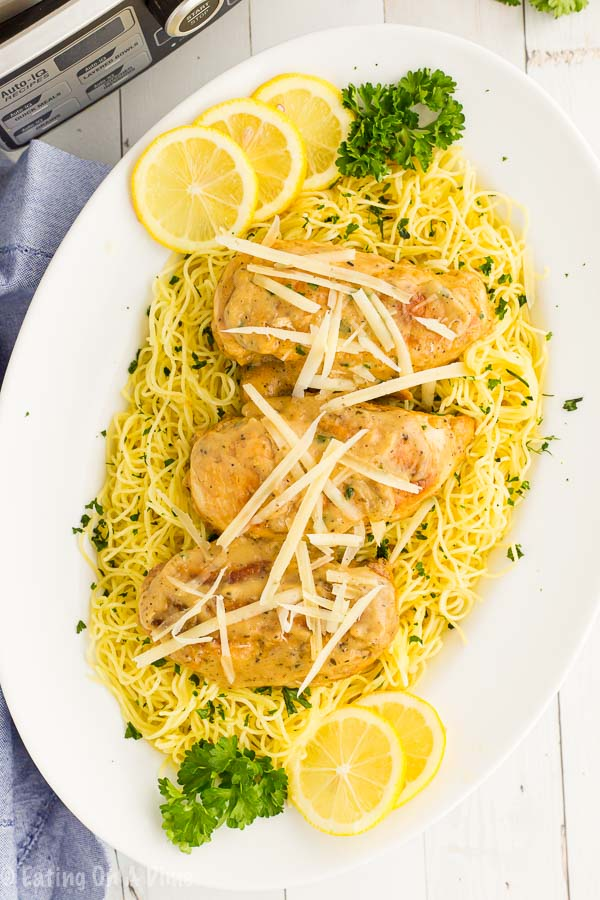 Crockpot lemon chicken is so light and refreshing for a great meal. The creamy lemon sauce is delicious over the chicken and pasta for an easy dinner idea.