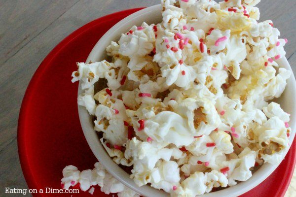 This Valentine's Day White Chocolate Popcorn Recipe is easy to make and everyone loves it! It is the perfect Valentine's Day Treat!