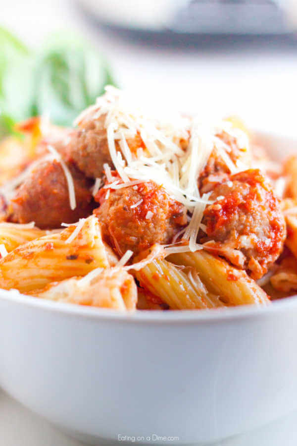 up close photo of  pasta and meatballs