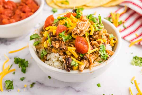 Crock pot salsa chicken recipe has just 4 ingredients and makes an easy dinner. Serve this tasty chicken in tacos, burritos, salads and more