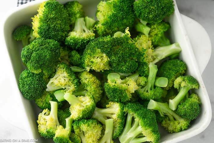 A large dish of freshly steamed, bright green broccoli