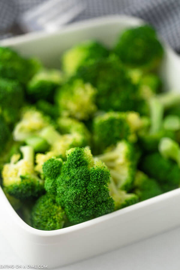A large container of freshly steamed broccoli