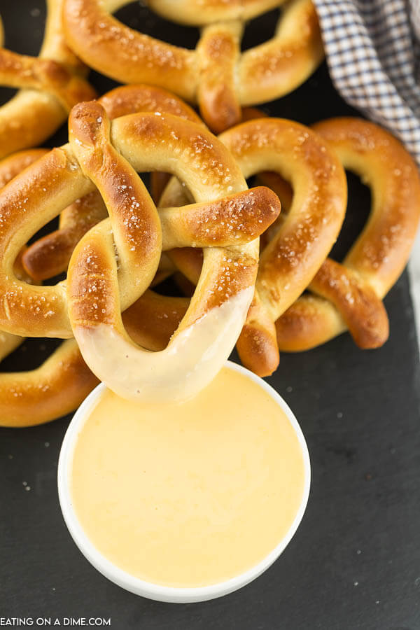 bowl of cheese sauce and pretzels