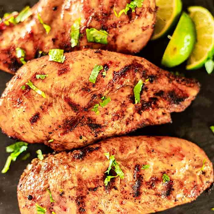 This easy Chicken Taco Marinade is perfect for the grill, crockpot, or the oven. Your family will be asking for grilled Mexican chicken over and over again!
