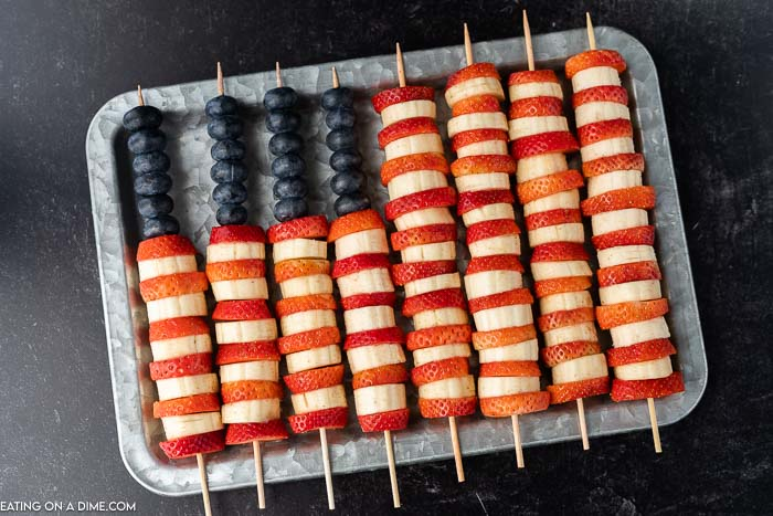 Platter of fruit skewers in flag design.