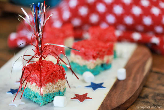 The kids just love these 4th of July rice krispie treats! These red white and blue rice krispie treats are quick and easy to make and are a crowd pleaser!