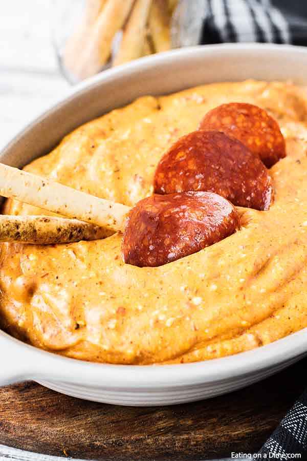 Pepperoni Pizza Dip will be an instant hit! Don't wait for your next party to enjoy this creamy pizza dip! It is the perfect low-carb version of pizza!