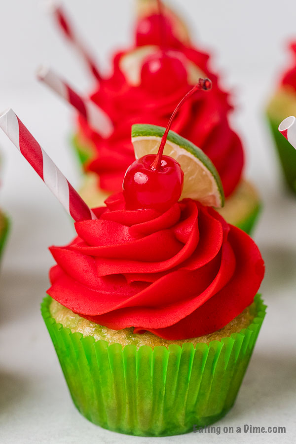 Closeup picture of cherry limeade cupcake in a green cupcake liner