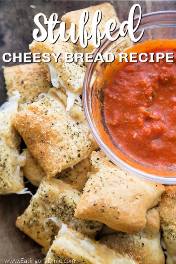 You just have to make this Stuffed Cheesy Bread Recipe with crescent rolls. This is the best cheesy bread and it only takes 15 minutes to make! Try this easy bread recipe. #eatingonadime #appetizerrecipes #breadrecipes