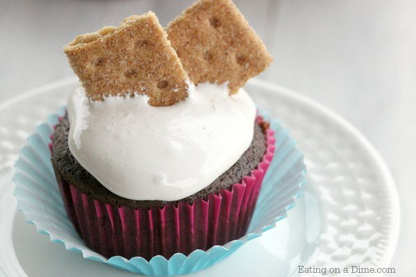This delicious Smores cupcake recipe will satisfy all of your cravings for ooey gooey smores. Each bite is decadent and the perfect dessert.