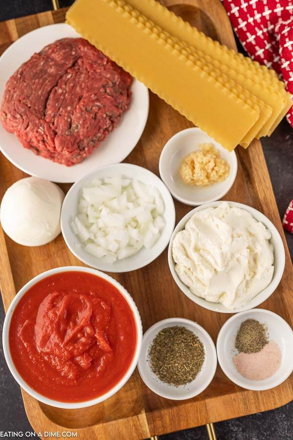 Ingredients needed to make this recipe: ground beef, lasagna noodles, olive oil, onion, garlic, salt, pepper, Italian seasoning, crushed tomatoes, mozzarella cheese, ricotta cheese and parsley