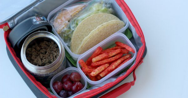Close up image of taco ingredients in a lunch box.