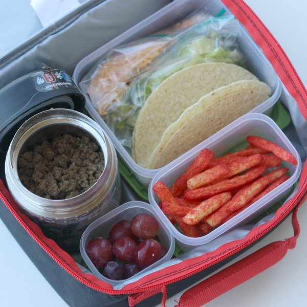 Close up image of taco ingredients in a lunch box