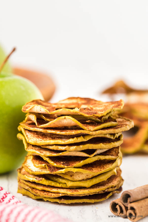 Baked Apple Chips stacked on top of each other