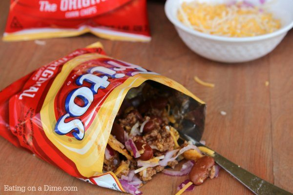 What are walking tacos? Try this Walking Taco Recipe with Fritos! Yes, walking tacos frito chili pie style. easy dinner ideas