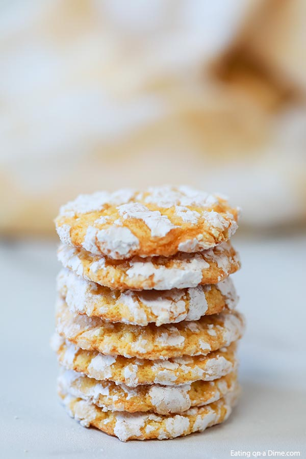 These easy Lemon Cake Mix Cookies are delicious! Just 4 ingredients to make Lemon Crinkle Cookies with cool whip. You'll love this recipe for lemon cookies using a cake mix! I love easy dessert recipes. #eatingonadime #dessertrecipes #cookierecipes