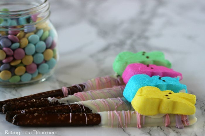 Looking for an Easy Easter Dessert? These easy PEEPS Chocolate Covered Pretzels Rods can be made in minutes but look adorable!