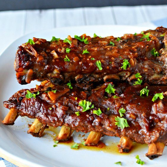 This slow cooker pork ribs recipe is easy to make and are fall off the bone tender! You'll never make ribs in the oven again once you make crock pot ribs! This is the best rib recipe ever! #eatingonadime #crockpotrecipes #dinnerrecipes