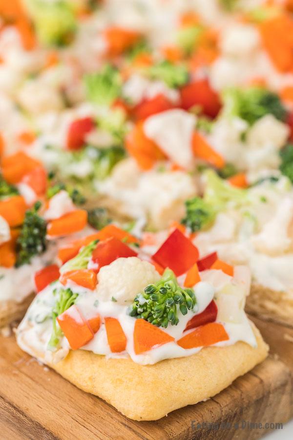 close up photo of veggie pizza slices
