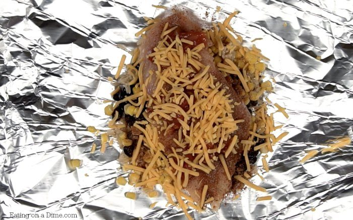 Looking for a quick and Easy Foil Packet recipe? You are going to love this simple Foil Pack Santa Fe Chicken Dinner. It will be your favorite grilling recipe!