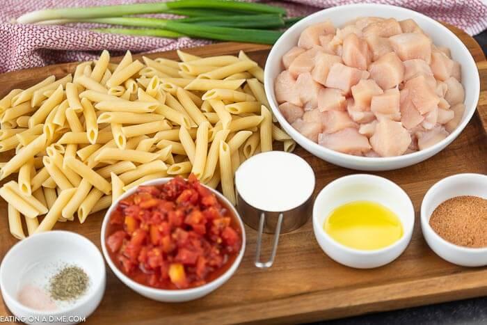 Ingredients to make creamy cajun chicken pasta: Chicken, olive oil, fire roasted tomatoes, cajun seasoning, heavy cream, penne pasta, salt, pepper and fresh parsley