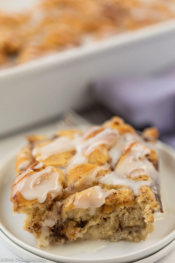Photo of closeup square of cinnamon roll french toast serving on a white plate.