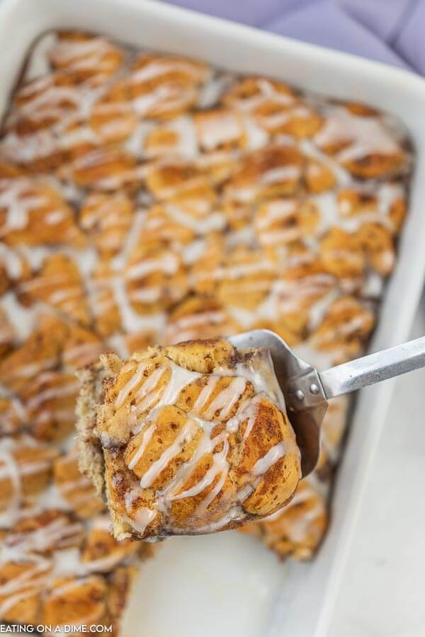 Closeup photo of cinnamon roll french toast casserole in baking dish.