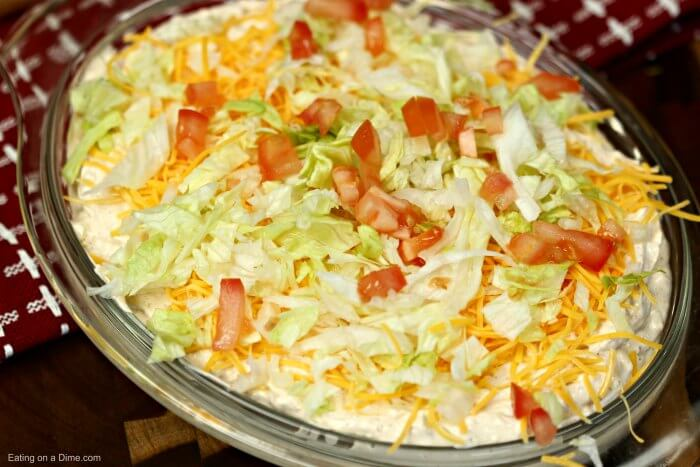 This is the best taco dip recipe. With a few ingredients you can throw together this easy taco dip recipe in minutes. Try this simple taco dip recipe today!