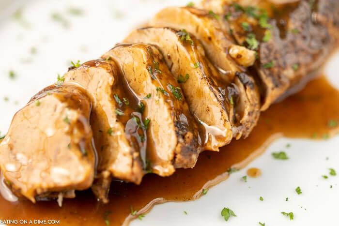Close up image of pork tenderloin with balsamic glaze.