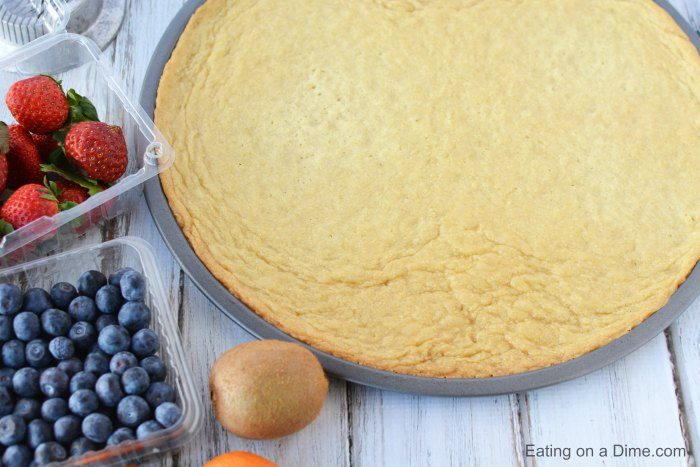 Make this delicious Sugar Cookie Fruit Pizza and you will not be disappointed! This Easy Fruit Pizza Recipe is amazing! You will love this fruit pizza with sugar cookie crust. Yum! Fruit pizza recipe sugar cookie will be a hit.