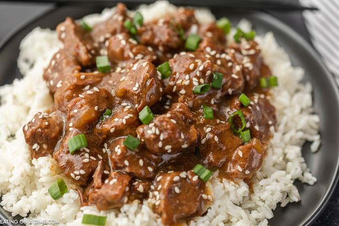 crock pot teriyaki over rice on black plate