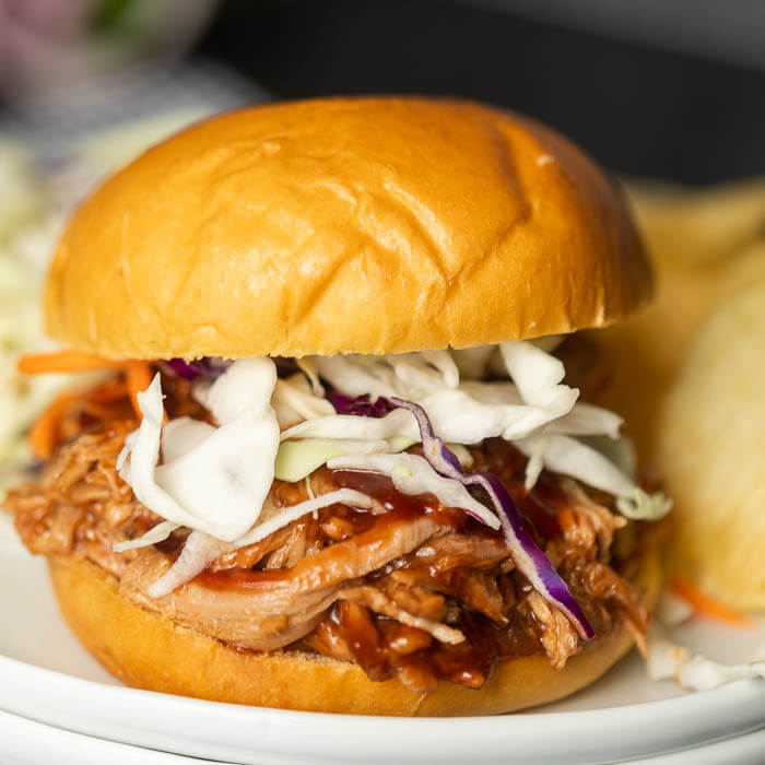 Instant pot pulled pork recipe is a quick and easy dinner idea! There is lots of tender pork packed with flavor piled high on a fluffy roll!