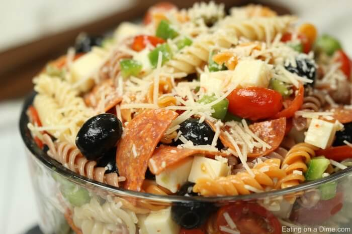 Italian pasta salad recipe is loaded with olives, tomatoes, cheese and more! Easy Italian pasta salad has the best flavor and will be a hit. Pasta salad with Italian dressing is the perfect side dish.Bring this Easy pasta salad recipe to parties, BBQ's and more! Cold pasta salad with Italian dressing is so easy.