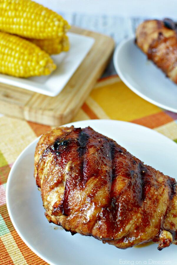 Grilled Bacon Wrapped Chicken Recipe is packed with flavor! Bacon wrapped bbq grill chicken is simple and delicious. Try BBQ bacon wrapped chicken!