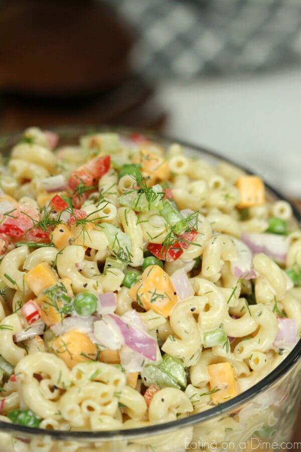This Easy Macaroni Salad recipe is the perfect side dish to bring to Summer BBQ's, parties and more! Easy macaroni salad is loaded with veggies, cheese and more. You will love the creamy dressing in Macaroni salad recipe. Try this Pasta salad with mayo. Everyone will love this simple Elbow macaroni salad!