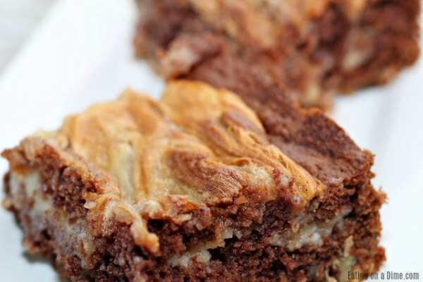 You will love this easy German Chocolate Cake Cheesecake Bars Recipe! Cheesecake and German chocolate make a tasty dessert. Try this easy dessert.