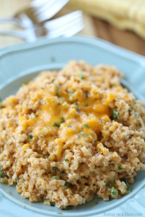 Looking for an easy keto side dish? You're going to love Easy Cheesy Cauliflower Rice. With just a few ingredients you can have Keto Cheesy Cauliflower.