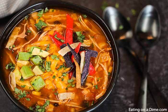 Crockpot Chicken Tortilla Soup Recipe is the best comfort food and it is so simple to make in the slow cooker. This recipe can feed a crowd!