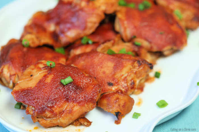 Crock Pot Sticky Chicken has a delicious brown sugar and tomato sauce glaze that will have you scraping the bowl clean. This sticky chicken is the best!