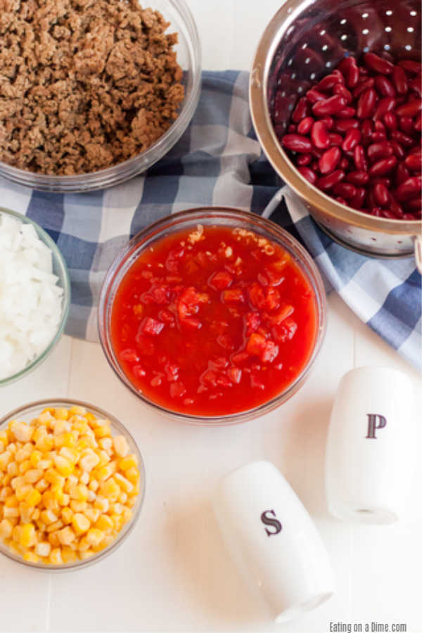 Crockpot Cowboy Casserole Recipe has everything you need for a tasty meal. Packed with flavorful ground beef, hearty beans, cheese and more!