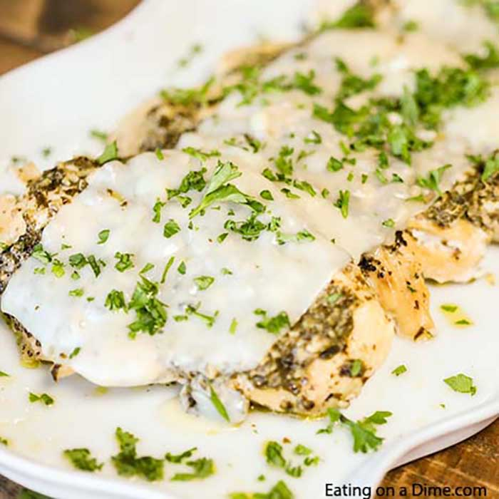 Crock Pot Pesto Chicken Recipe is keto friendly and tasty. The tender and flavorful chicken is topped with pesto and cheese for a meal everyone will love.