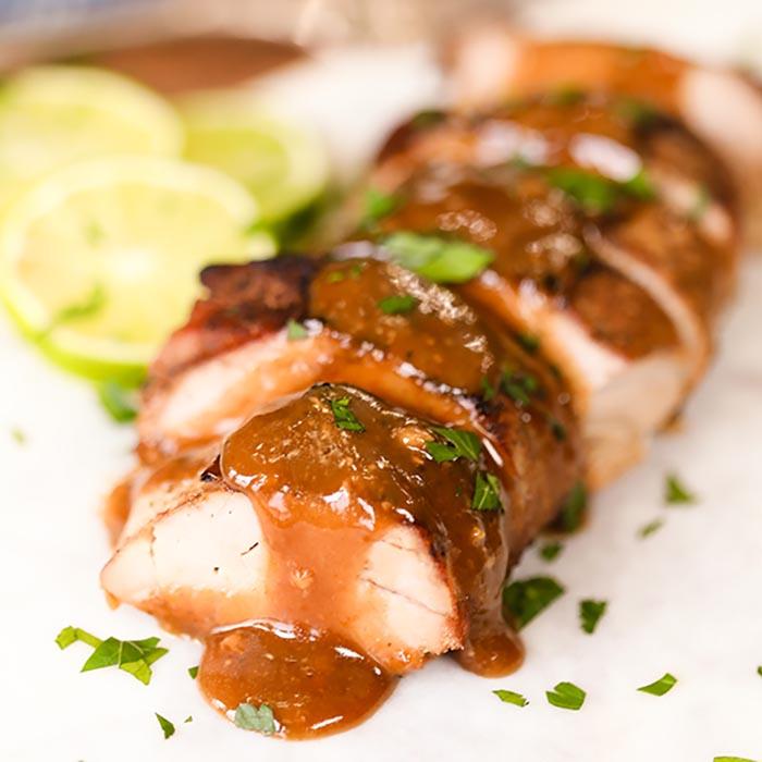 Tender crock pot pork tenderloin and delicious honey lime drizzle combine for the best recipe. The slow cooker makes this so easy for busy weeknights. #eatingonadime #honeylimeporktenderloin #slowcookereasy