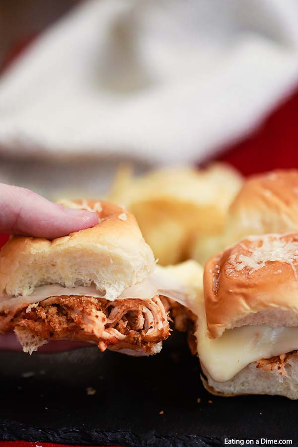 Crock Pot Chicken Parmesan Sliders are so fun to make and eat. They are perfect for family dinner, Game day, parties and more! The chicken is amazing.