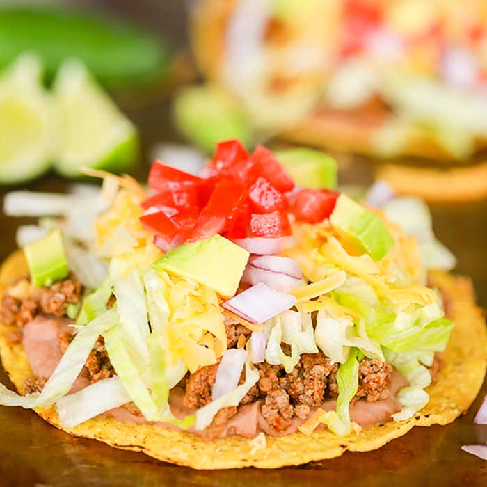 Ground Beef Tostada Recipe is such a fun dinner idea and tasty too. Serve this meal for your family or make tostadas for a crowd. This meal is so easy.
